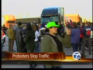 Protesters stop traffic at the Ambassador Bridge
