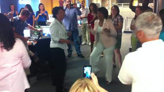 Diana Lewis leads the WXYZ newsroom in dance to Celebration