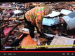 VIDEO: Elderly woman finds dog in rubble