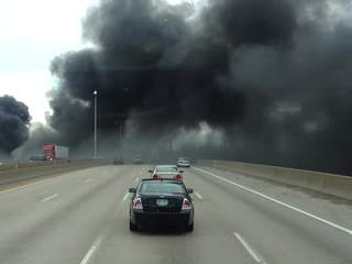 Smoke_from_fire_near_I_75_and_Rouge_Rive_602810000_JPG