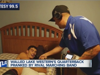 Rival school band wakes up QB on 1st school day