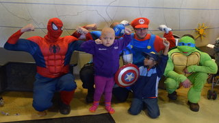 Superheroes wash hospital windows, surprise chil