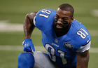 Lions invite Calvin Johnson to training camp