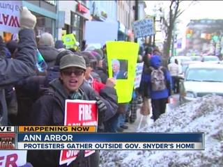 Dozens protest Gov. Snyder outside his home
