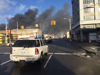 Crews battle massive warehouse fire