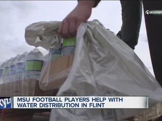 MSU football players lend a hand in Flint