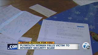Woman warning others of computer scam