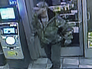 Police search for armed robber in Monroe County