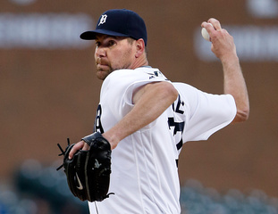 Hill outduels winless Pelfrey as A's top Tigers