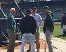 Harbaugh visits with A's, Tigers