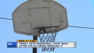 Single mother fights to get basketball hoop back
