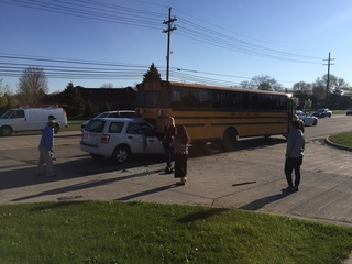 Driver crashes into back of school bus in Macomb