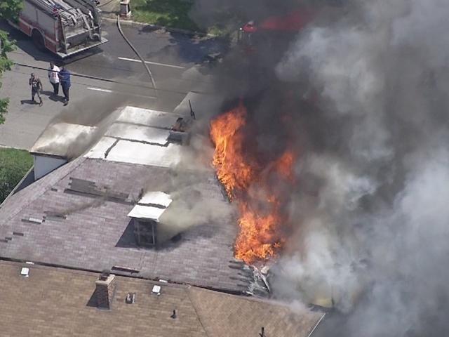 Firefighters battle large house fire in Detroit