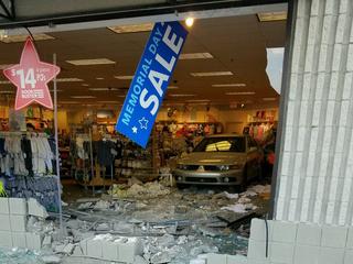 Car backs into Farmington Hills Carter's store