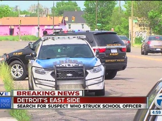 School officer struck by car, search for suspect