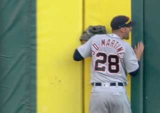 J.D. Martinez leaves game with fractured elbow
