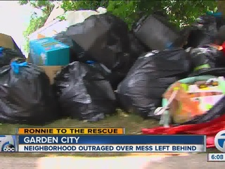 Owner leaves trash pile in yard after moving