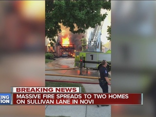 Massive fire spreads to two homes in Novi