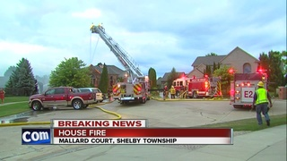 Crews battle large house fire in Shelby Township