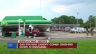 Storm winds knock gas station canopy onto cars
