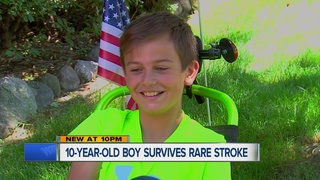 Young boy doesn't let rare stroke slow him down