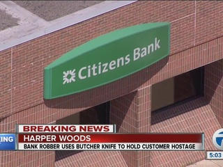 Woman arrested after Harper Woods bank robbery