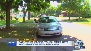 Man stays inside car during standoff w/ repo man