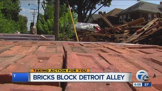 Bricks keep Detroit neighbors from their garages