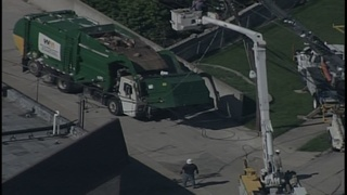 Downed power lines trap person in garbage truck