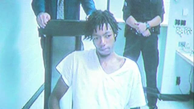 Suspect arraigned on charges in smash-and-grab