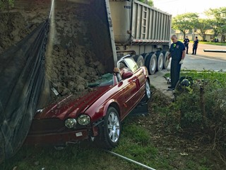 Driver rescued after gravel hauler accident