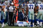 Tony Romo has broken bone in back