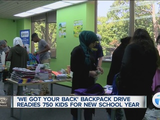 Volunteers fill hundreds of backpacks for kids