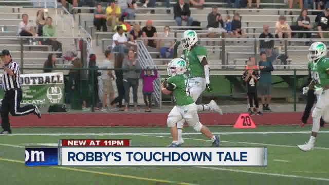 Teen with Down syndrome scores touchdown as cancer-stricken mom looks on