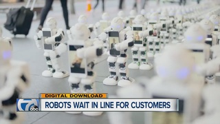 Cute robots replace humans in line for iPhones
