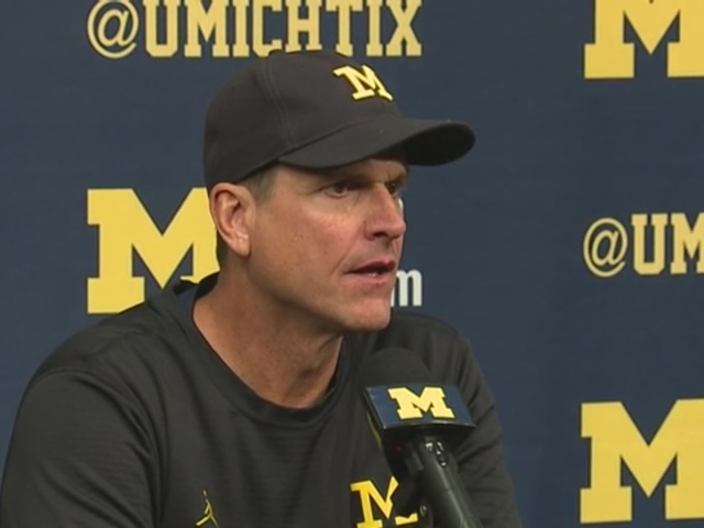 MI coach Jim Harbaugh speaks out on his players protesting national anthem