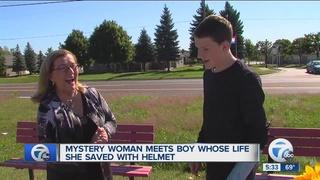 Boy reunited with woman who gave him bike helmet