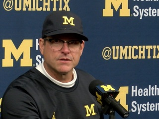 Harbaugh pays homage to Hayes with new glasses