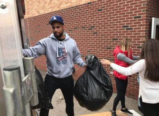 Lions player, teens team up for coat drive