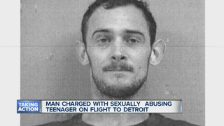 Man charged with groping girl on plane