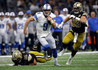 Stafford, defense lead Lions over Saints