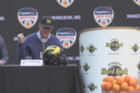 Harbaugh recalls story of knocking coconut