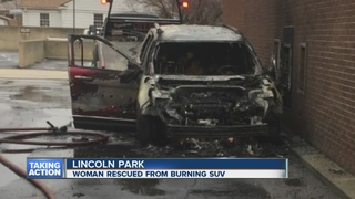 Woman saved from burning SUV at bank ATM