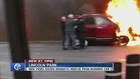 VIDEO: Rescuers pull woman from burning van