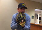 Harbaugh shows off new baseball glove