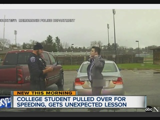 Cop helps student tie a tie after traffic stop