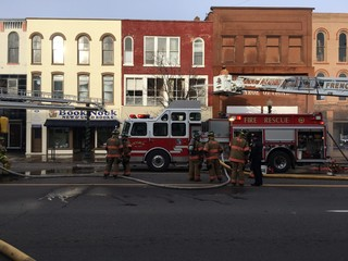 Crews battle building fire in downtown Monroe