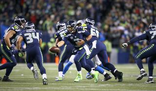 Wilson, Rawls power Seahawks past Lions
