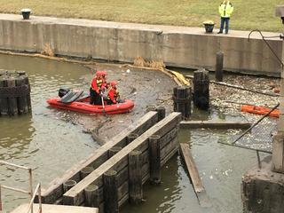 Crews rescue dogs trapped in water in Dearborn