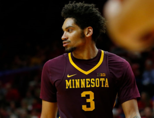 Murphy, Minnesota outlast Michigan in OT